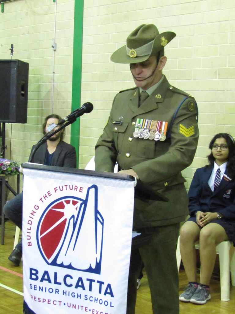 Sergeant Bert Van Der Vlugt of the Royal West Australian Regiment addressing the ceremony
