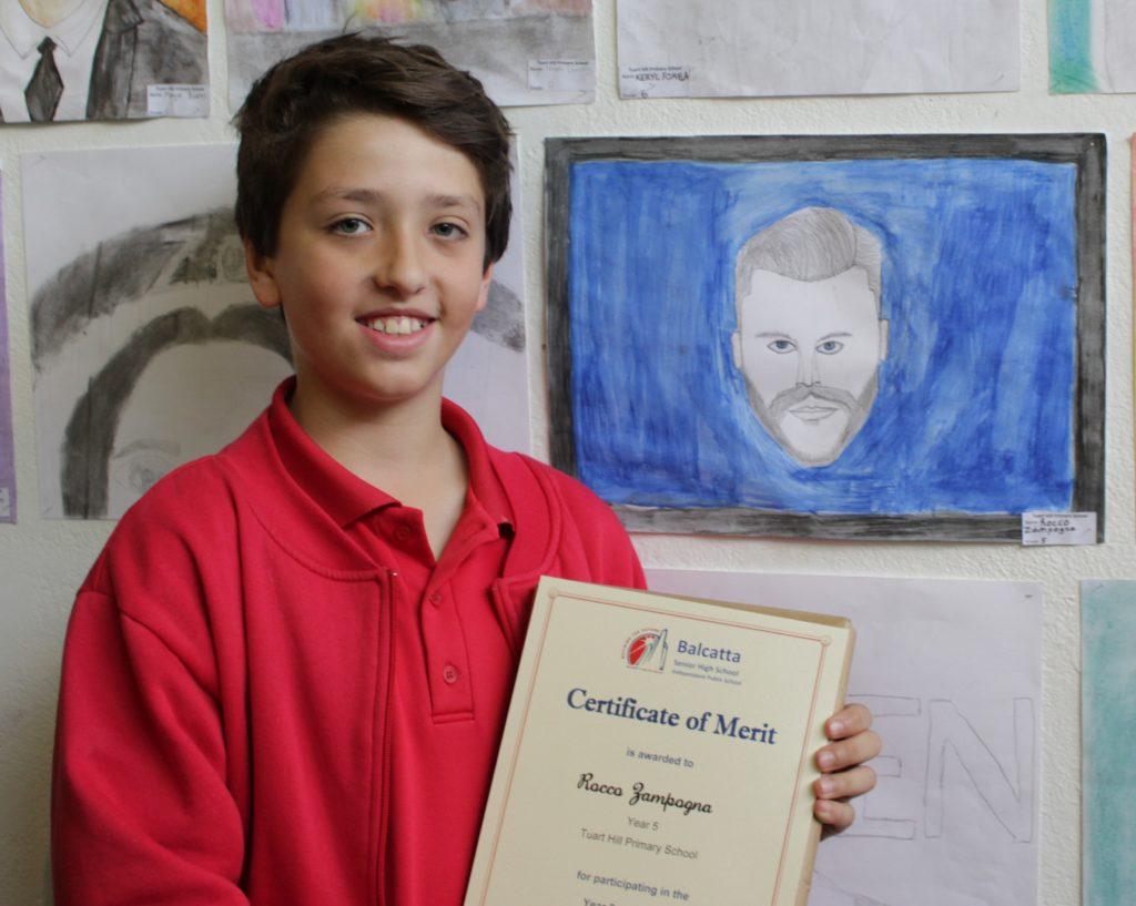 Rocco Zampogna, Year 5 Tuart Hill PS next to his artwork