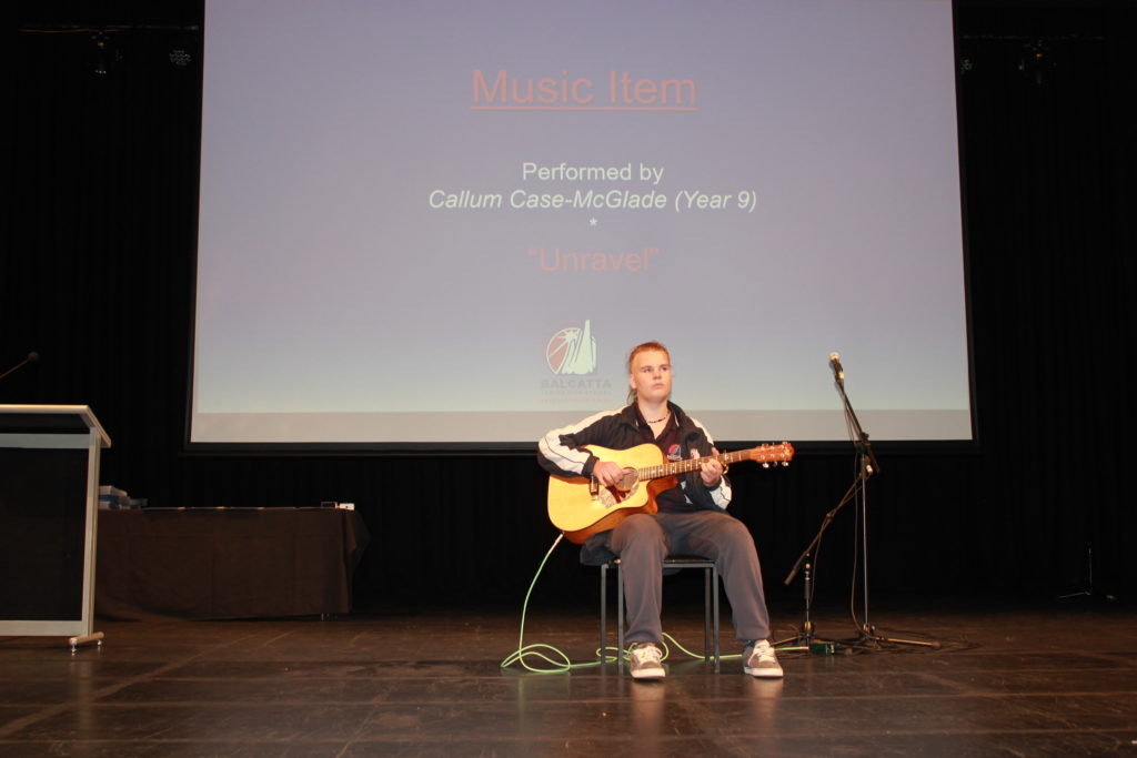 Callum Case-McGlade (Year 9) performing an instrumental solo performance)