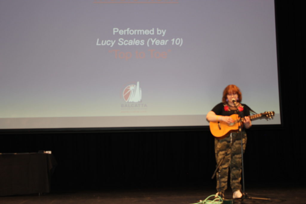 Lucy Scales (Year 9) solo performance (singing/guitar)